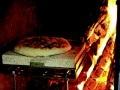 Pizza im Kamin